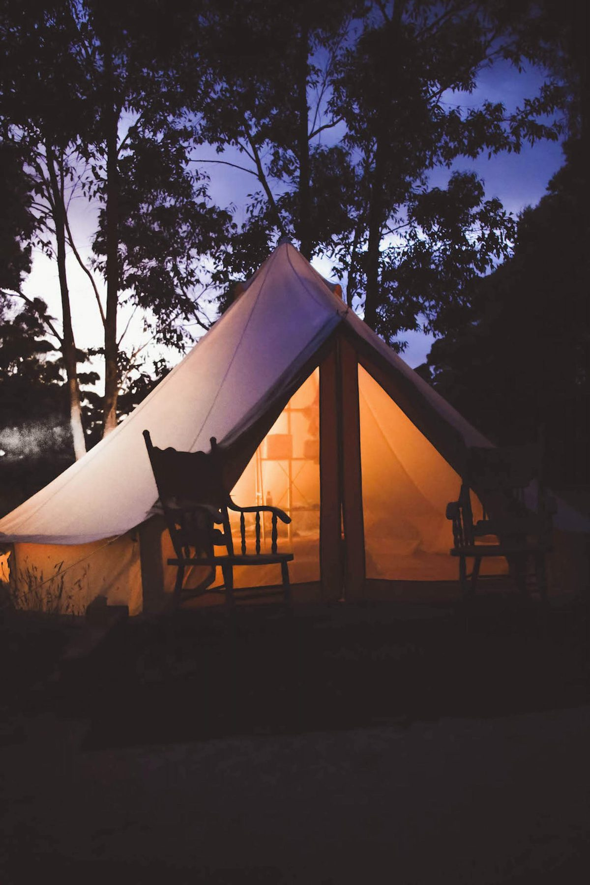 Canvas tent with rocking chairs outside