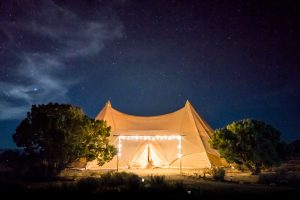 Canvas tent at night with lights
